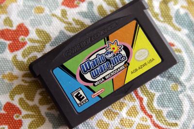 Used Video Game Reviews: Sega Genesis, Mega Microgames, Toy Commander: WarioWare: Mega Microgame$ (Game Boy Advance)