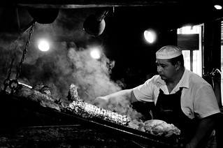 Image of Mercado del Puerto. street portrait blackandwhite bw white black puerto uruguay blackwhite beef cook streetphotography bbq meat grill mercado chef barbecue parrilla montevideo asado churrasco mercadodelpuerto