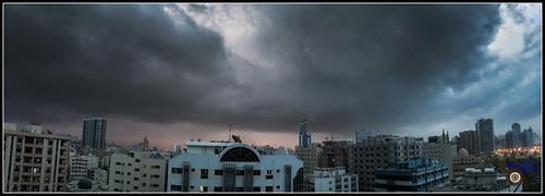 sky cloud sunrise buildings lights skyscrapers sharjah unitedarabemirates darkclouds