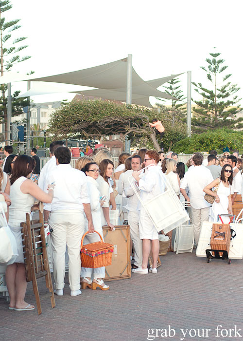 Diners with picnic chairs and tables waiting for Diner en Blanc Sydney 2013