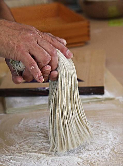 soba noodles in hand
