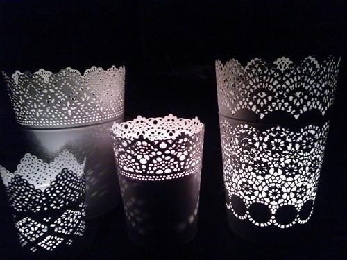 White lace-like metal luminaries, night light playing from votive candles, Seattle, Washington, USA by Wonderlane