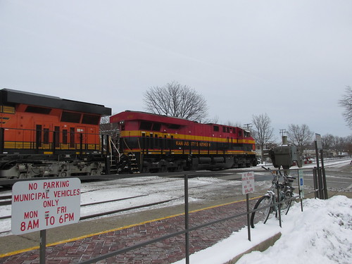 Eastbound BNSF Railway freight train with a Kansas City Southern Railroad locomotive up front.  Riverside Illinois.  December 2013. by Eddie from Chicago