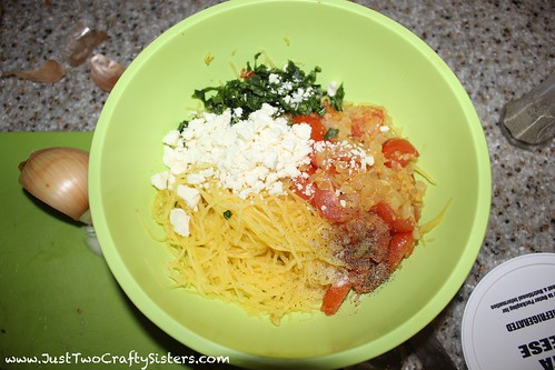 Yummy spaghetti squash salad with feta, basil, tomatoes, onion and garlic.  So good!!!