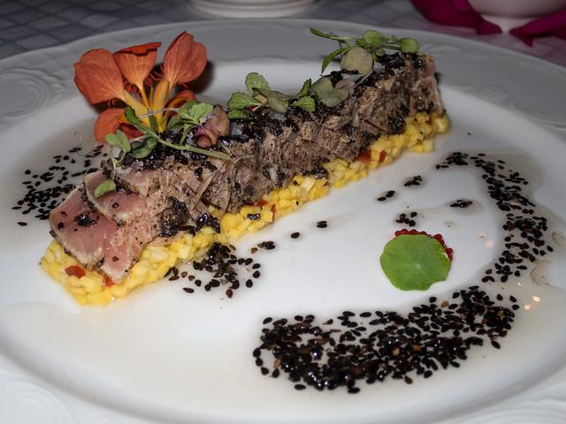 Tuna tataki on mango and sweet chili tartar with black sesame dressing