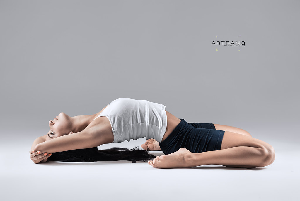 woman in supta virasana yoga position
