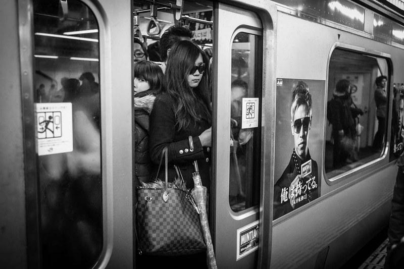 Matching sunglasses. Shinjuku station, Tokyo.