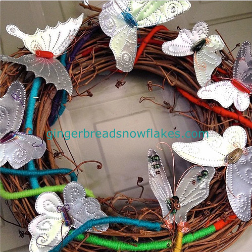 Punched tin butterfly and grapevine wreath