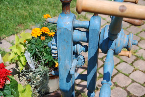 Painted blue wood antique click reel winding yarn gear detail