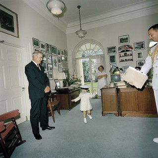 John F. Kennedy, Jr. Plays with Hat in White House