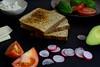 Preparing an avocado and tomato sandwich