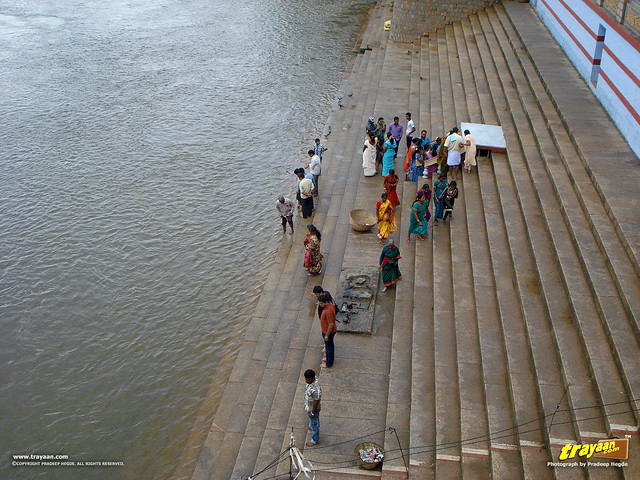 Tunga riverside at Sringeri, where devotees feed the fish, in Sringeri, Chikkamagalur district, Karnataka, India