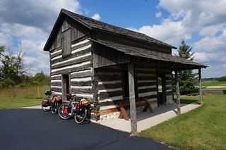 Log cabin along bike path