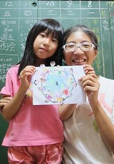 張明麗與女兒;攝影:黃福惠;圖片來源:上下游新聞市集