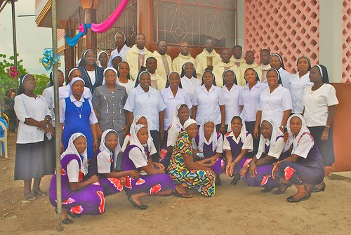 Sisters, postulants and aspirants standing with Priests and other religious at the official opening of the Dassa Postulancy in May 2014