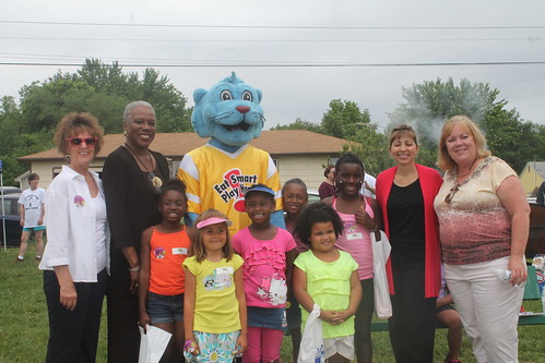 Rowe with kids and the Power Panther at the PowerHouse Ministries site in Marshall, MO.