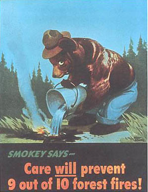 For the first two years of the Smokey Bear campaign, artist Albert Staehle's art showed Smokey hard at work putting out fires. USDA archives photo.