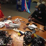 Malachi and Camryn trying to fix some broken r/c helicopters