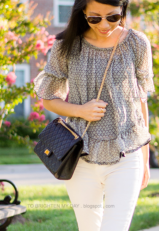 ruffled silk top, black crossbody bag, white jeans