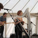 Georgia Ruth playing the electric harp