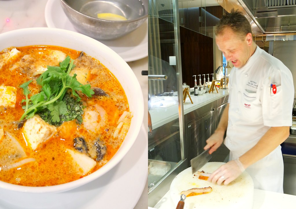 mariott cafe's Laksa and Executive Sous Chef Matthew Van Der Zwan is actually cutting up the Roasted Pork