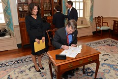 Under Secretary for Management Patrick F. Kennedy signs the appointment papers for Dana Shell Smith to become the U.S. Ambassador to Qatar in an official ceremony at the U.S. Department of State in Washington, D.C., on July 24, 2014. [State Department photo/ Public Domain]