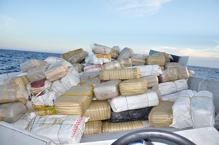 A panga boat loaded with an estimated 12,000 pounds of marijuana aboard floats approximately 180 miles southwest of San Diego after being seized by the Coast Guard, July 29, 2014. Coast Guard Cutters Stratton, Petrel and Haddock apprehended four suspects and seized two panga boats in addition to the marijuana. (Photo by U.S. Coast Guard Cutter Stratton)