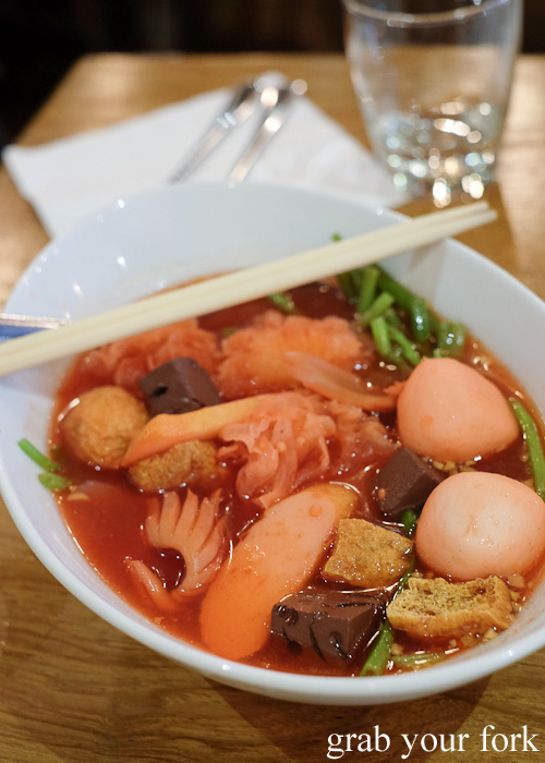 Guay Teow Yen Ta Four rice noodle soup with fish ball in red bean sauce at Tawandang Thai-German restaurant, Sydney