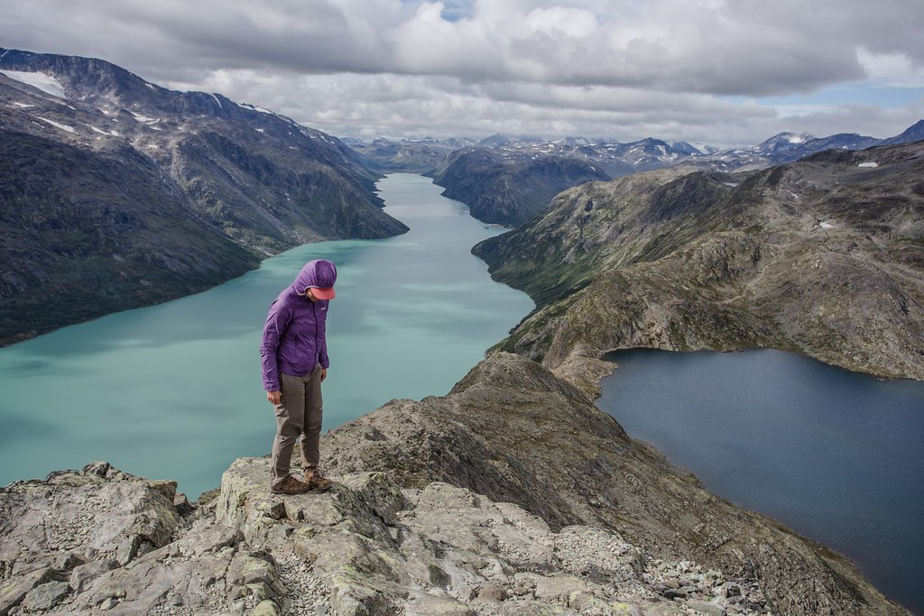 The walk over Besseggen ridge  is one of the most popular mountain hikes in Norway. About 30,000 people walk this trip each year. From Besseggen there is a great view over azure Gjende (glacial) and dark Bessvatnet lake. Jotunheimen NP. Norway.
