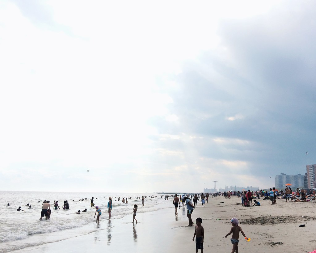 Brighton Beach with Luna Park in Coney Island in the background.  Labor Day, 2014