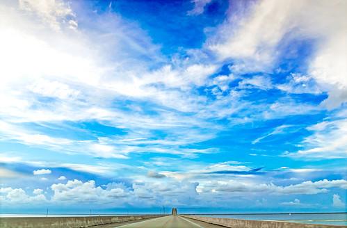 road travel bridge sky usa water clouds day driving alabama sunny bluesky gulfcoast dauphinisland mobilecounty dauphinislandbridge