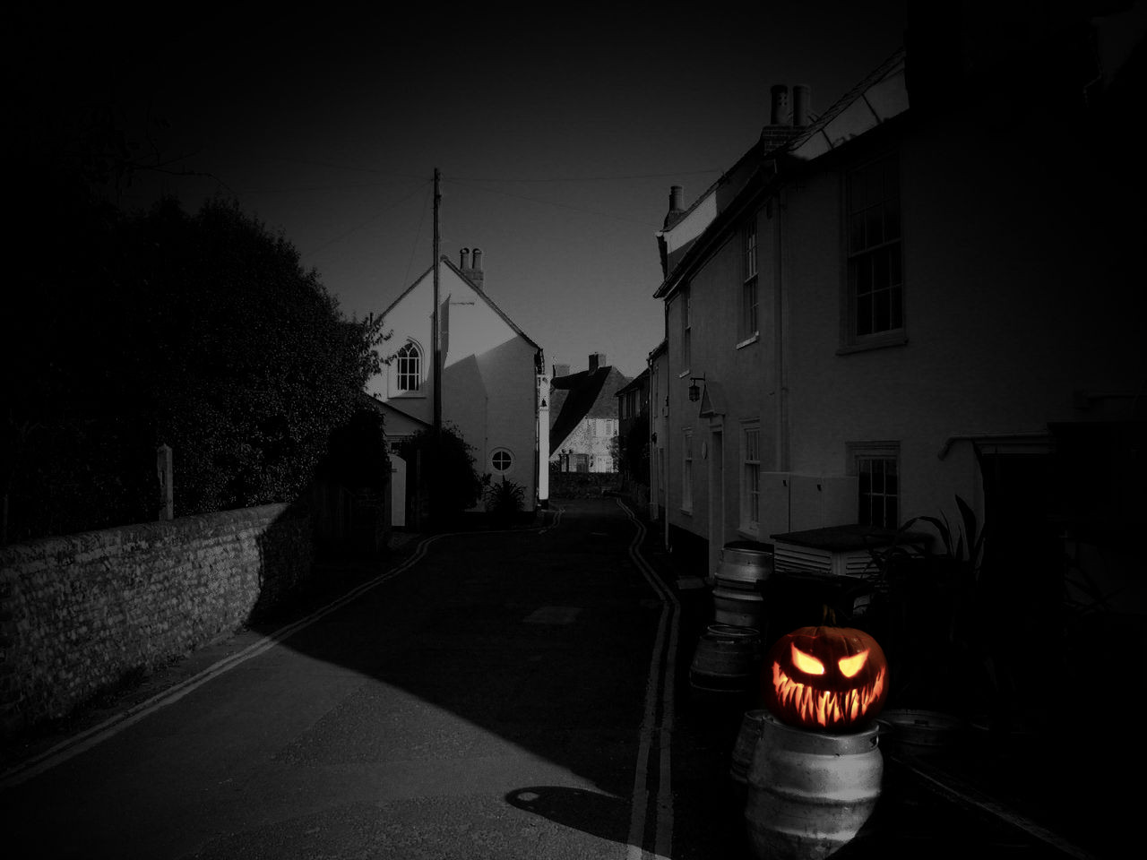 A Jack o Lantern guards a village against evil spirits