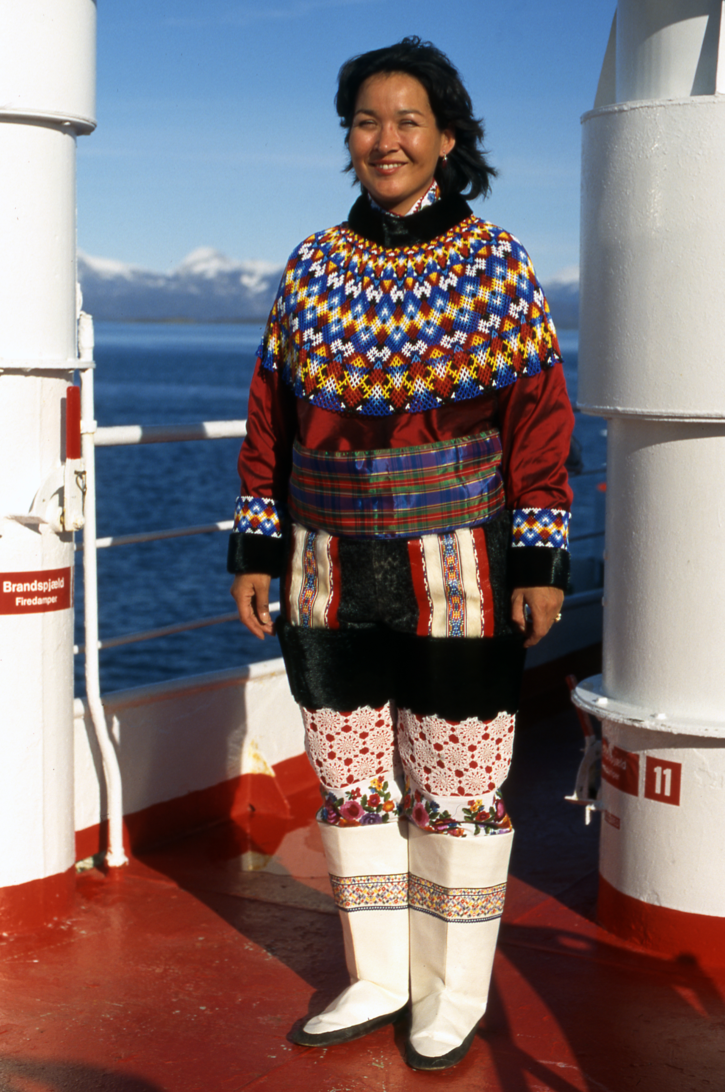 Greenlandic Inuit Woman In Traditional Dress On Cruise