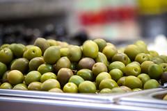 agriculture(0.0), vegetable(0.0), plant(0.0), crop(0.0), olive(1.0), produce(1.0), fruit(1.0), food(1.0),
