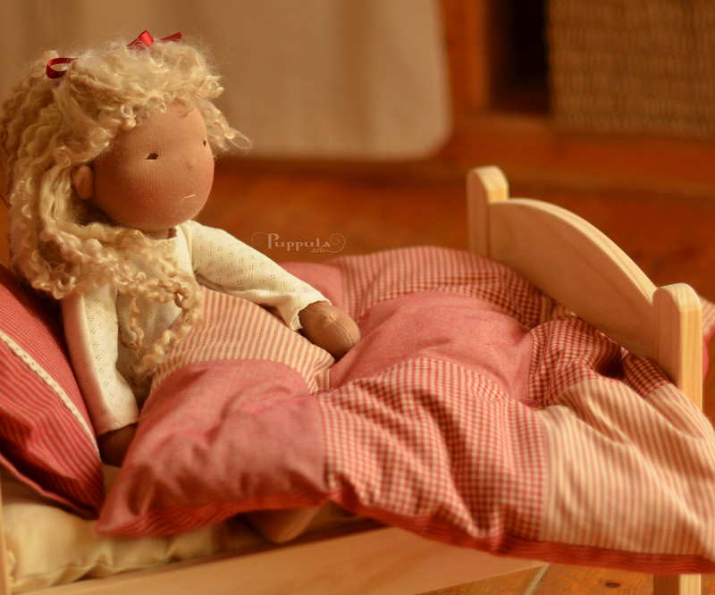 Doll bedding in reds