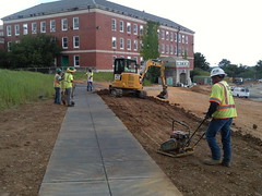 Sidewalk installation and backfill at CBTC.
