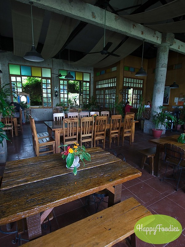 Nice wooden tables, colorful windows and lively indoor plants