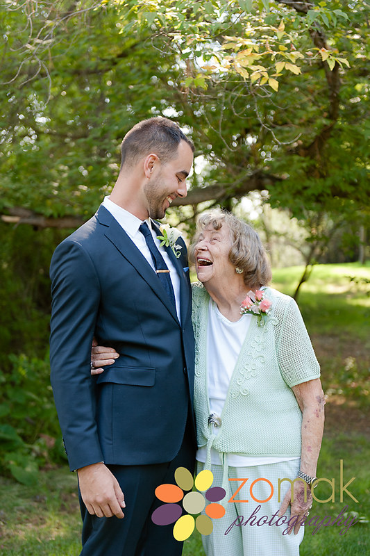 A moment of laughter is shared between the groom and his grandmother.