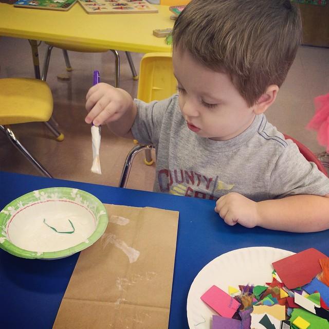 William gluing at school. He loves preschool!! #kids #preschool #preschooler #baby #toddler #toddlerlife