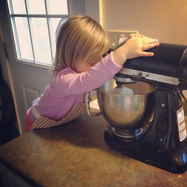 Helping mama make bread.