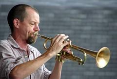 sousaphone(0.0), tuba(0.0), trombone(0.0), horn(0.0), trumpet(1.0), music(1.0), trumpeter(1.0), brass instrument(1.0), wind instrument(1.0),