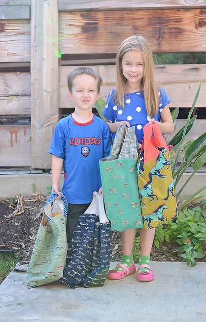 kids with cotton and steel grocery bags