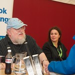 George R R Martin signs books for fans at the Edinburgh International Book Festival |