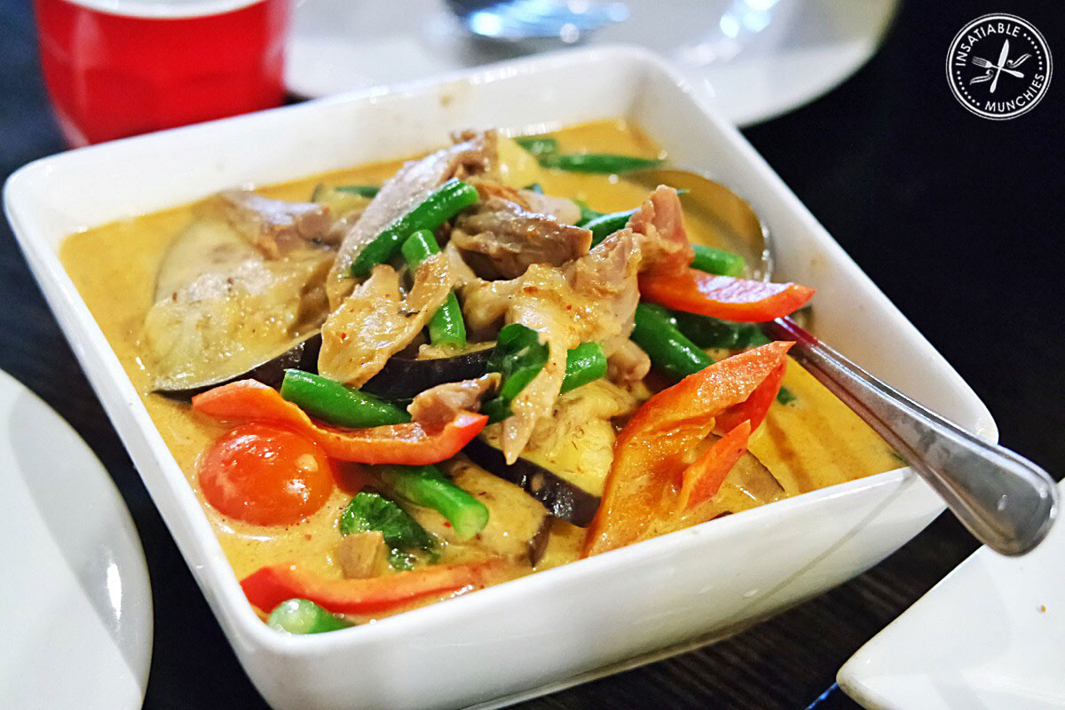 Pieces of duck is cooked in a creamy red curry with fresh vegetables like capsicum, carrots, green beans and eggplant.