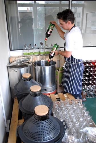 Thomas Aske of Fluid Movement prepares batched cocktails