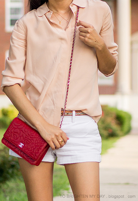 nude blouse, piped glitter belt, red crossbody bag, white shorts