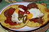 Huevos rancheros with chorizo and refried beans