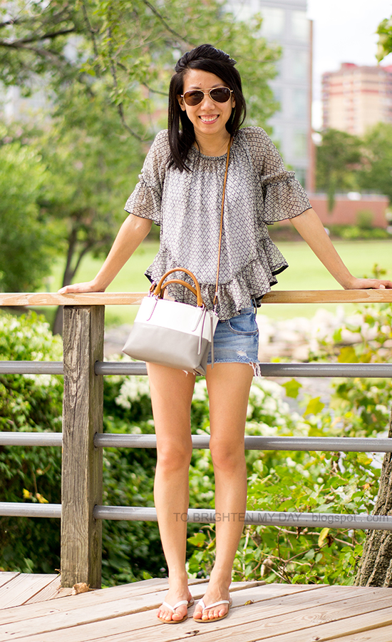 patterned ruffled top, distressed shorts, colorblock crossbody bag