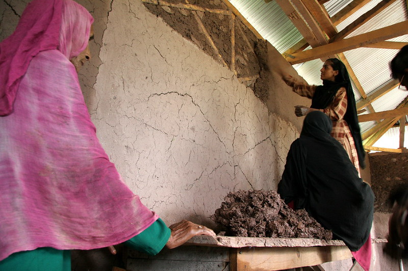 Women repairing their home Pakistan