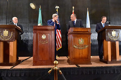 U.S. Secretary of State John Kerry chats with Egyptian Foreign Minister Sameh Shoukry before they and Arab League Secretary-General Nabil al-Araby and United Nations Secretary-General Ban Ki-moon hold a news conference in Cairo, Egypt, on July 25, 2014, to discuss efforts to reach a cease-fire in fighting between Israel and Hamas in the Gaza Strip. [State Department photo/ Public Domain]